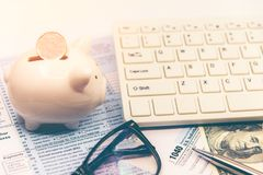 Calculating tax for  income tax return for saving tax, target for save coin in the piggy bank. Royalty Free Stock Images