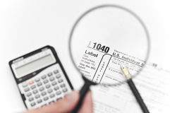 Calculating taxes stock images