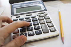Calculating the taxes Stock Photography