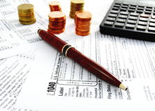 Calculating US Taxes 1040 Form Stock Images