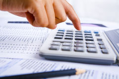 Calculating using calculator Royalty Free Stock Photos