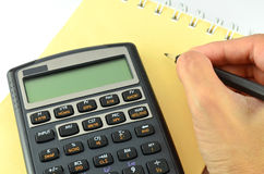 Calculating by using financial calculator Royalty Free Stock Images
