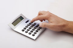 Calculating on the white Desk Stock Image