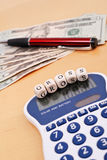 Calculating your Gross Profits. Calculator With Gross And American Tender In Background royalty free stock photos