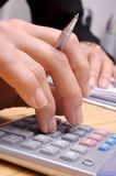 Calculation 2. Hand & calculator Royalty Free Stock Images