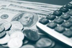 Calculation. Dollar coin and a calculator. selective focus Royalty Free Stock Photos