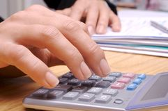 Calculation 3. Hand & calculator Stock Photo
