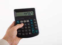 Calculation. A pocket calculator in use royalty free stock photos
