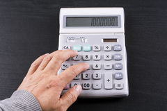 Calculation on calculator Stock Image