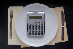 Calculation of diet on the calculator Royalty Free Stock Photos