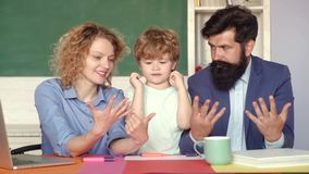 Calculation on fingers, counting fingers. Educational process. Supporting pupils at school. Parents feeling proud on. Progress of son. Kids gets ready for stock footage
