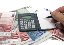 Calculation with money Royalty Free Stock Photos