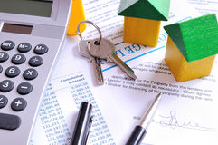 Calculation of mortgage loan and signed agreement top view Stock Photo