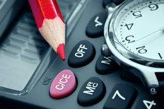 Calculation of profit. Watch and calculator-planning and calculation of profit stock images
