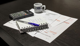 Calculation of the utility bills. Scene with pen, bills, calculator and coffee Stock Images