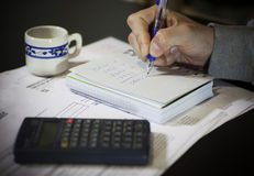 Calculation of the utility bills. Scene with pen, bills, calculator and coffee Royalty Free Stock Photos