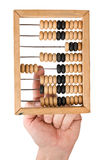 Calculation on wooden accounts Royalty Free Stock Photo