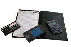 Calculations. Different calculators and the daily log on a white background Royalty Free Stock Images