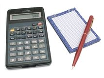 Calculations. The calculator with a notebook and the pen. The image contains a contour for cropping Royalty Free Stock Image