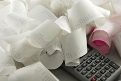 Calculations. Reams of calculator tape and a calculator Stock Photos