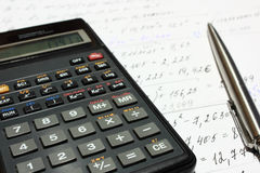 Calculations. The calculator, calculations and ball pen royalty free stock photography