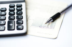 Calculations and account book and pen Royalty Free Stock Image