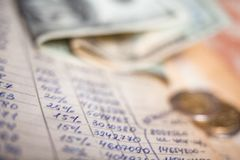 Calculations, banknotes and coins. Hand-written calculations, banknotes and coins. Bookkeeping accounting. Economy. Money savings and budget. Bank deposits stock image