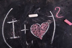 Calculations of love. Representation with chalk on the blackboard of calculations rappresentani love Royalty Free Stock Images