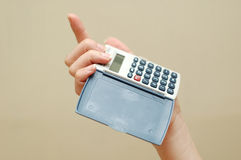 Calculative woman. Calculator and hand Royalty Free Stock Images