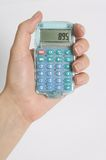 Calculator. Figuring costs on calculator Stock Photos
