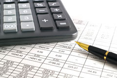Calculator. A calculator, pen, and financial statement Royalty Free Stock Photo