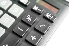 Calculator. Detail of a Calculator over white Royalty Free Stock Photo