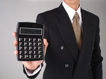 Calculator. Businessman holding a digital calculator Royalty Free Stock Photo
