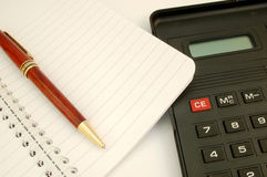 Calculator #2. With notebook and pen royalty free stock photos