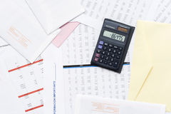 Calculator_2. A calculator on top of financial reports Royalty Free Stock Photo