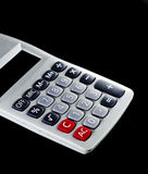 Calculator. White calculator with black background Stock Photography