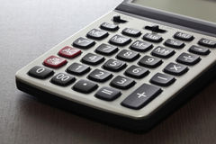 Calculator. On the wooden background Stock Photos