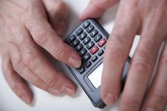 Calculator. Businessman's hand  with calculator Stock Images