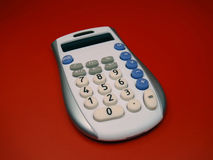 Calculator. Gadget on red background Stock Photography