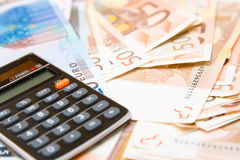 Calculator. With money(euro) background Stock Photos
