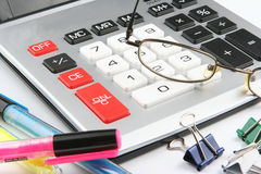 Calculator. Electronic calculator on desk for doing papper work accounting office Stock Image