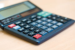 Calculator. On wooden office desk stock image