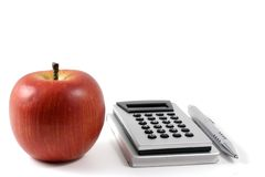 Calculator. Silver calculator and metal pen Royalty Free Stock Photos
