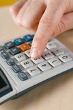 Calculator. Vertical image of calculator on desk Royalty Free Stock Images