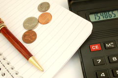 Calculator #7. With pen and coins stock photos
