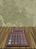 Calculator. On wood grain desk Royalty Free Stock Image