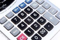 Calculator. An electronic calculator on white Stock Photo