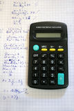 Calculator. On maths exercise book with drawings Stock Images