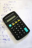 Calculator. On mathe exercise book Royalty Free Stock Photos