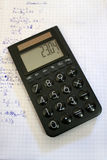 Calculator. On mathe exercise book Royalty Free Stock Photo